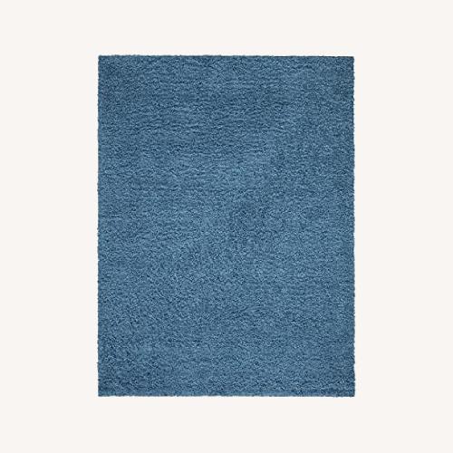 "Used Rugs USA 5'3"" x 7' Turquoise Shag Rug for sale on AptDeco"