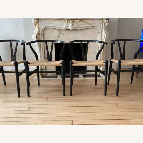 Used CH24 Black Wishbone Chairs set of 4 for sale on AptDeco