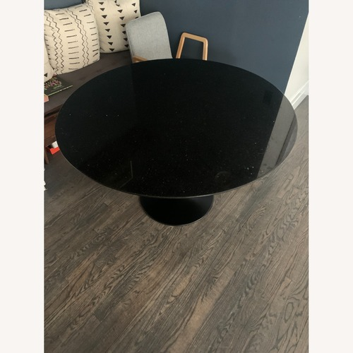 Used Modern Living Supplies Black Glass Marble Table for sale on AptDeco