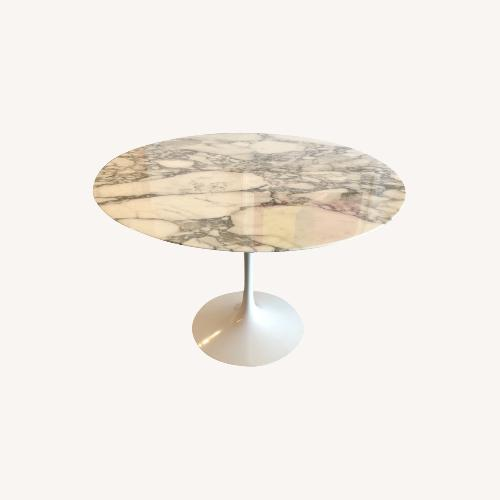 Used Eero Saarinen Dining Table (Arabescato Marble) for sale on AptDeco