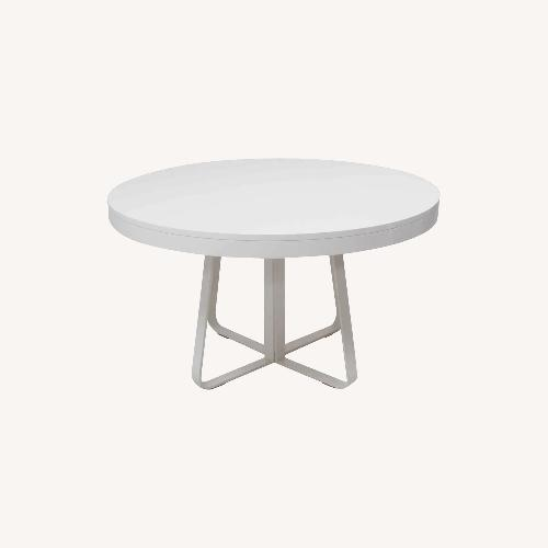 Used Ligne Roset Ava White Round to Oval Extend Table for sale on AptDeco