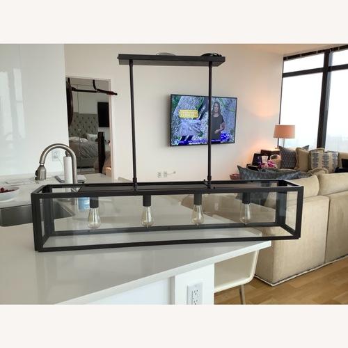Used Modern iron 4 Light Fixture for sale on AptDeco