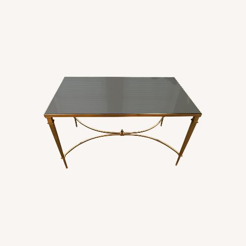 Used Global Views Brass and Black Granite Cocktail Table for sale on AptDeco