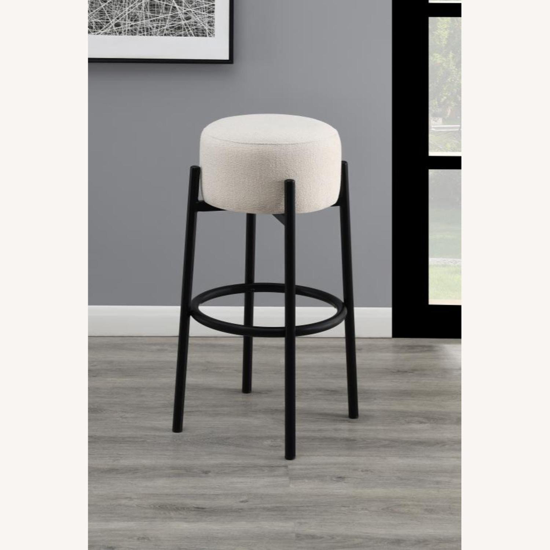 Bar Stool In White Upholstery & Black Metal Base - image-2