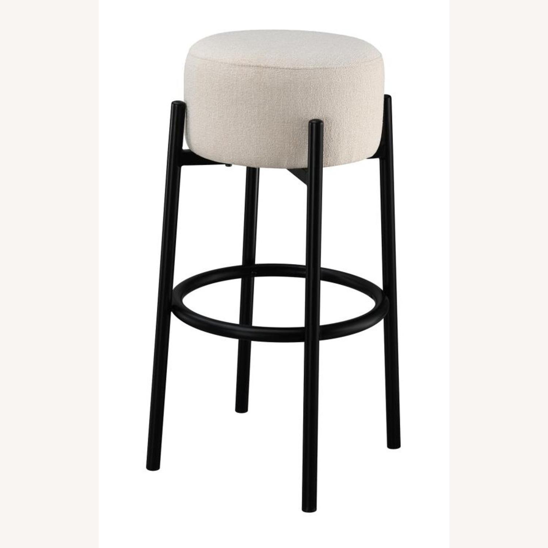 Bar Stool In White Upholstery & Black Metal Base - image-0