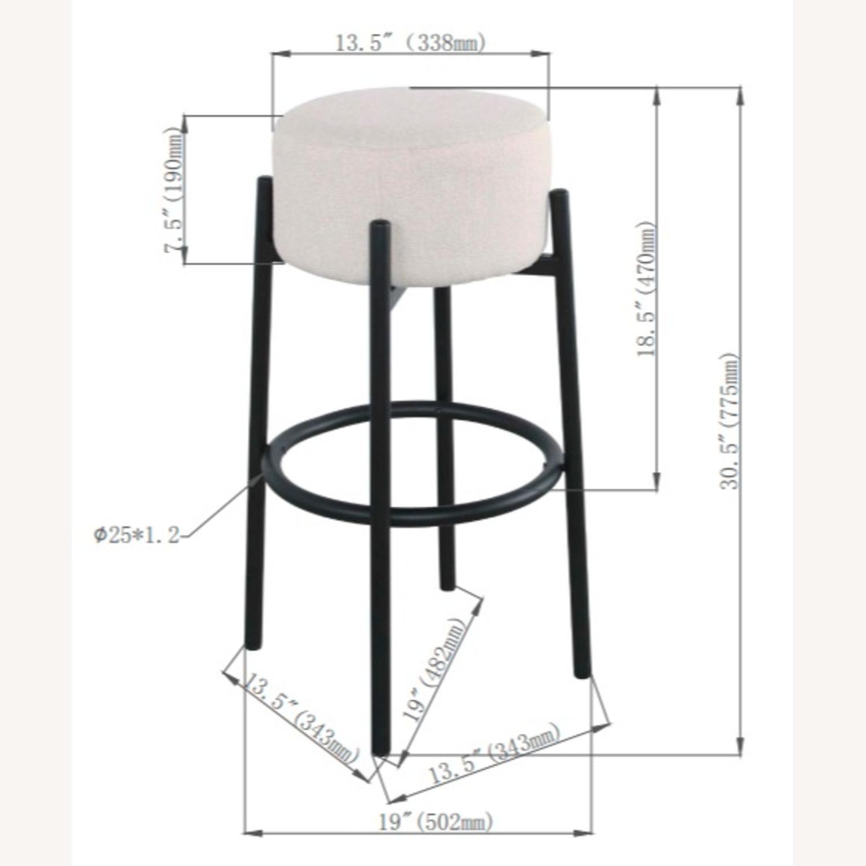 Bar Stool In White Upholstery & Black Metal Base - image-3