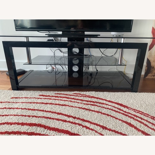 Used 3 Level Glass TV stand for sale on AptDeco