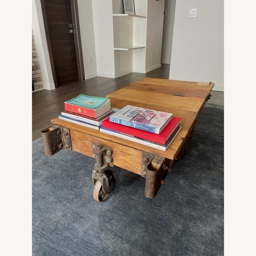 Used Vintage Industrial Railroad Cart Coffee Table for sale on AptDeco