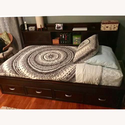 Used Raymour & Flanigan Twin Bed with Storage for sale on AptDeco