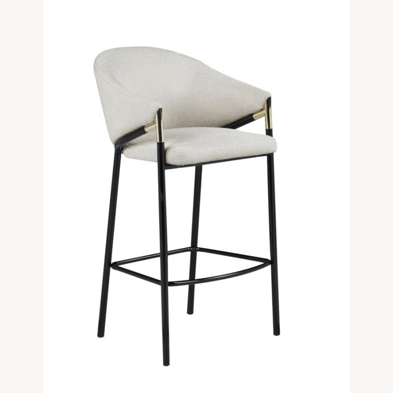 Bar Stool In Beige Upholstery & Glossy Black Legs - image-0