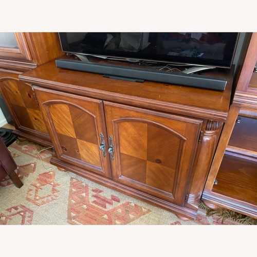 Used Tuscan Style Entertainment Center/ China for sale on AptDeco