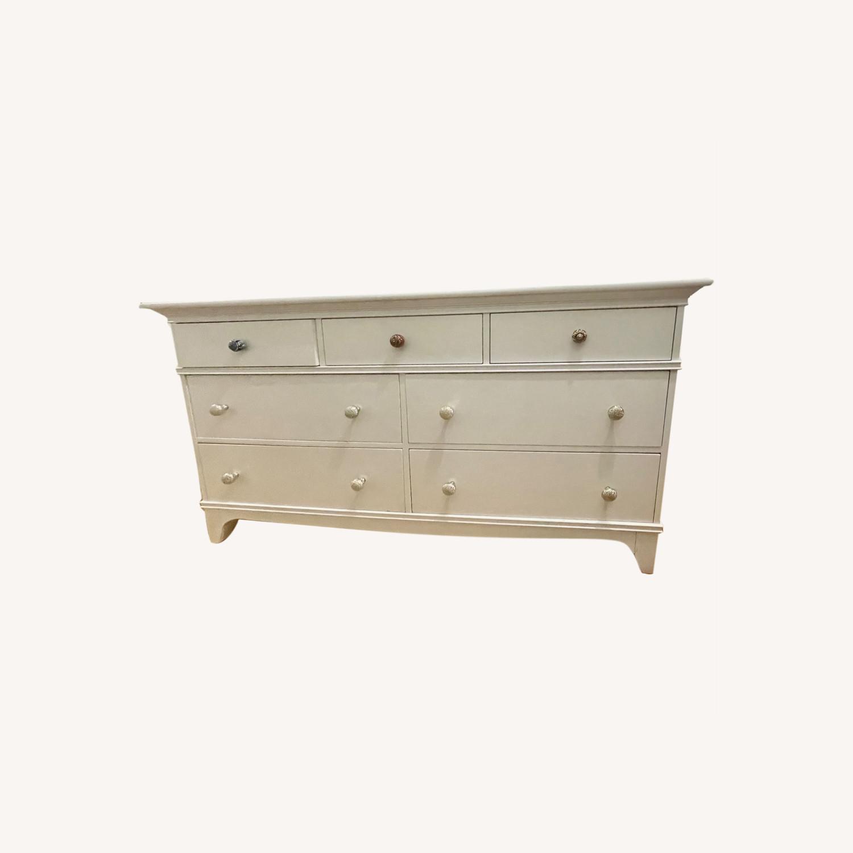 White Dresser with Unique Knobs - image-0