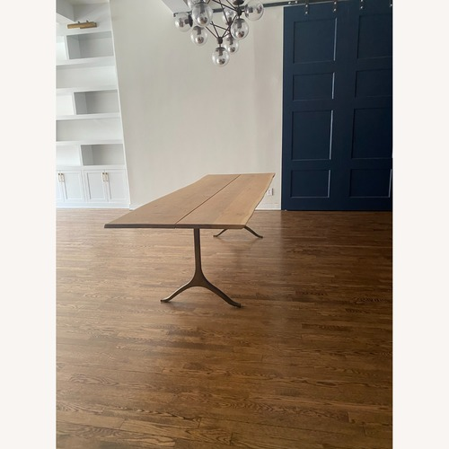Used Anthropologie Oak and Brass Live Edge Dining Table for sale on AptDeco
