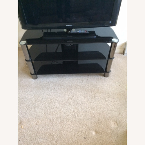 Used TV Stand with Three Shelves for sale on AptDeco