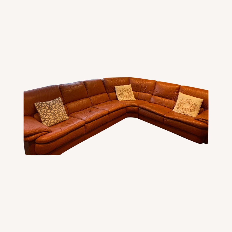 Natuzzi Leather Sectional - image-0