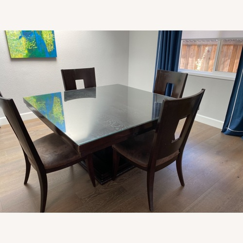 Used Square Pedestal Wooden Dining Table with 4 Chairs for sale on AptDeco
