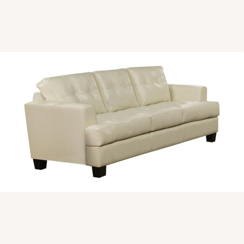 Sofa In Cream Leatherette W/ Top Stitch Details - image-1