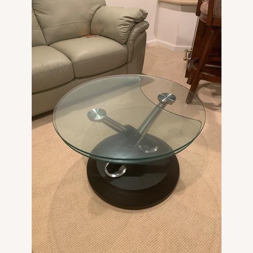 Used Glass Swivel Coffee Table for sale on AptDeco