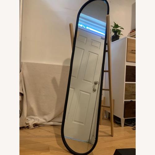 Used Umbra Hub Floor Mirror for sale on AptDeco