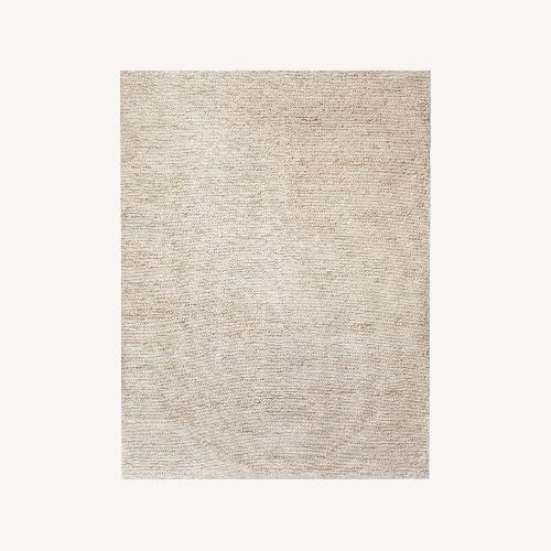 Used West Elm Mini Pebble Wool Jute Rug for sale on AptDeco