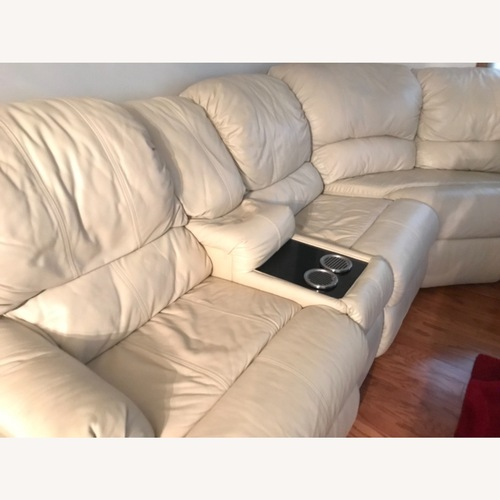 Used Natural Color Leather Sectional for sale on AptDeco