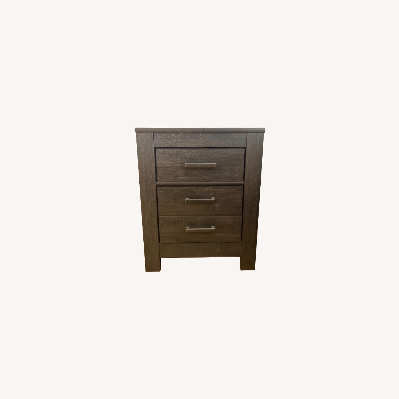 Ashley Furniture Dark Wood Nightstand with Metal Handles - image-0