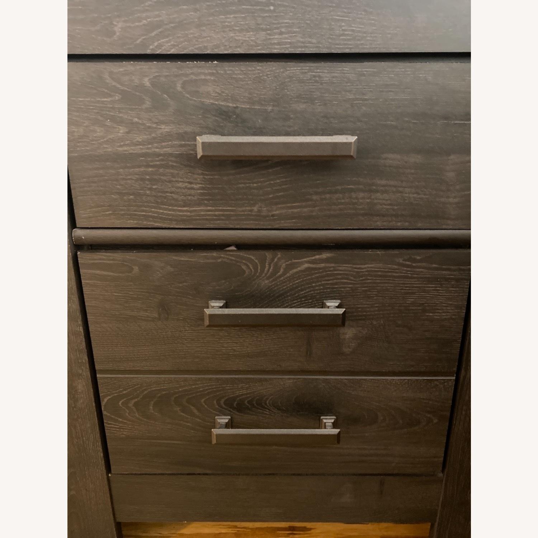 Ashley Furniture Dark Wood Nightstand with Metal Handles - image-6