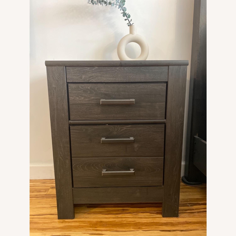 Ashley Furniture Dark Wood Nightstand with Metal Handles - image-1