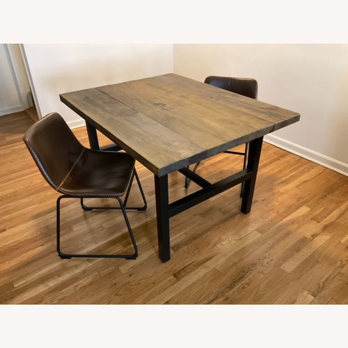 Used Industrial Style Dining Table and 2 Chairs for sale on AptDeco