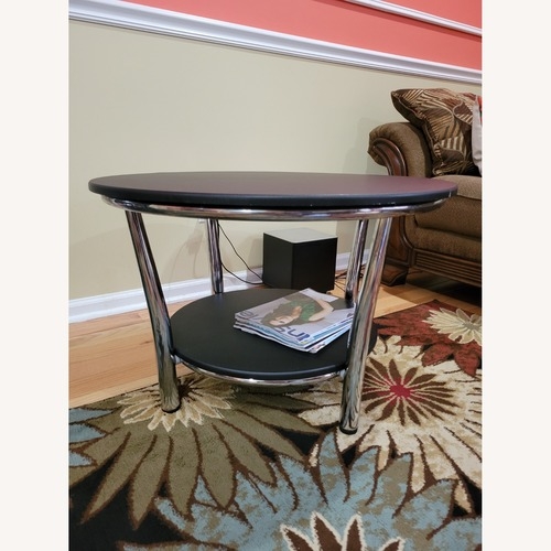 Used Maya Black Wood Metal Round Coffee Table for sale on AptDeco