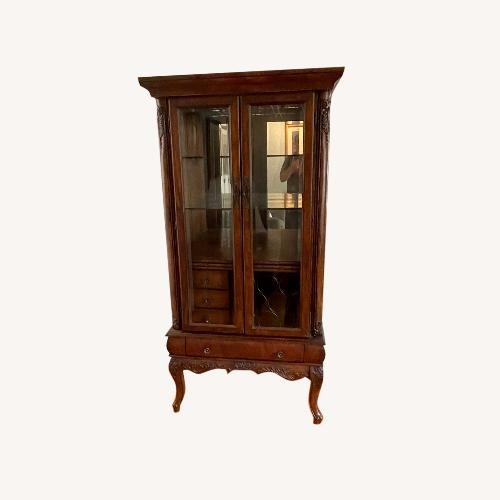 Used Wood Wine Bar/curio Cabinet for sale on AptDeco