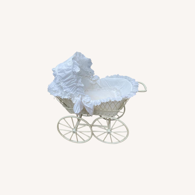 Vintage Wicker Baby Bassinet on Wooden Wheels - image-0