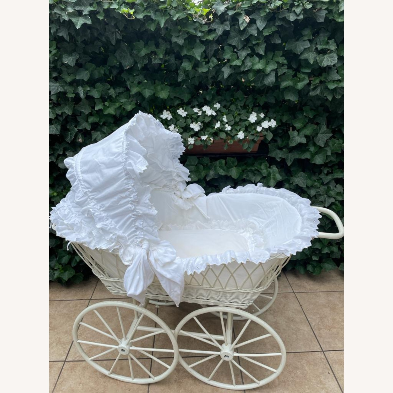 Vintage Wicker Baby Bassinet on Wooden Wheels - image-1