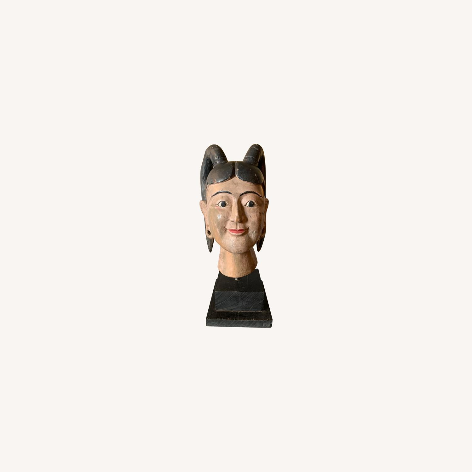 Carving of a Burmese Woman face in one solid piece - image-0