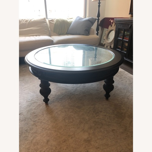 Used Ethan Allen Maya Round Coffee Table in Peppercorn for sale on AptDeco