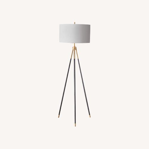 Used Rowe Furniture Black and Gold Tripod Floor Lamp for sale on AptDeco