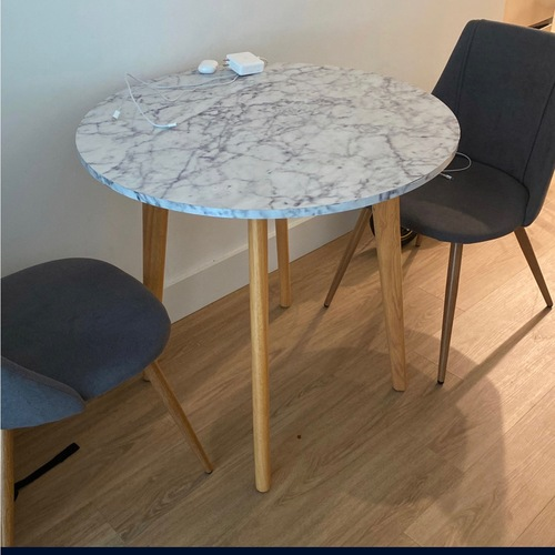 Used Marble Coated Table w/ Two Chairs for sale on AptDeco