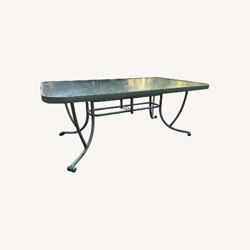 Used Patio Table & 6 Chairs for sale on AptDeco