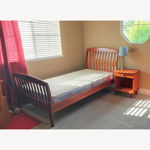 Used Scandinavian Designs Wood Twin Sleigh Bed for sale on AptDeco