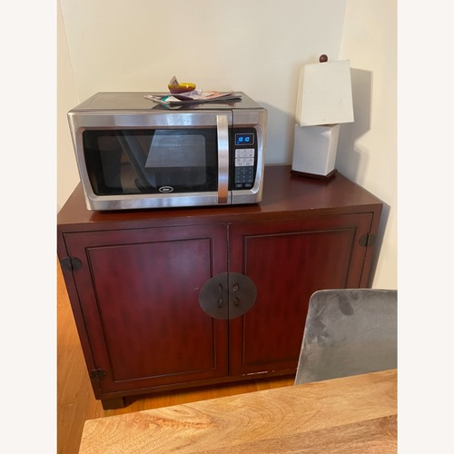 Used Red Wood Curio Cabinet for sale on AptDeco