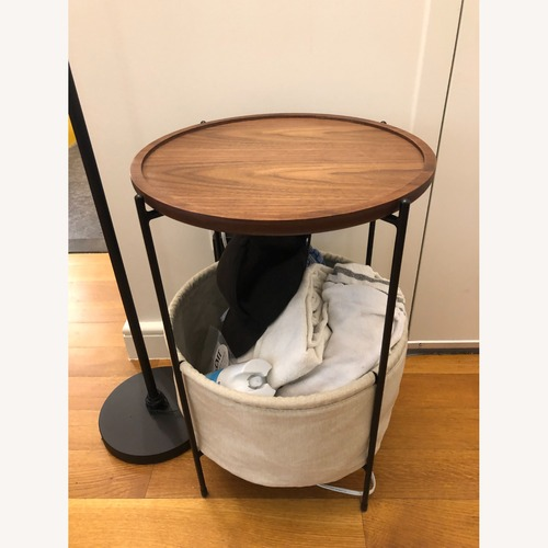 Used Rivet Meeks Round Side Table with Basket for sale on AptDeco