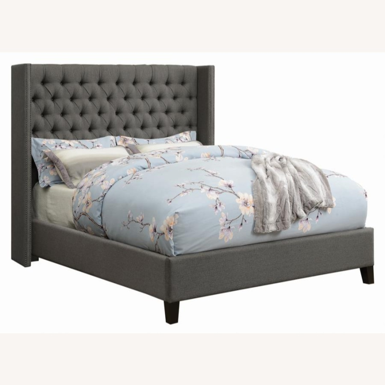Full Bed In Grey Fabric W/ Bronze Nailhead Trim - image-0