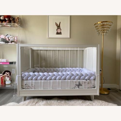 Used Pottery Barn Sloan Acrylic Crib for sale on AptDeco