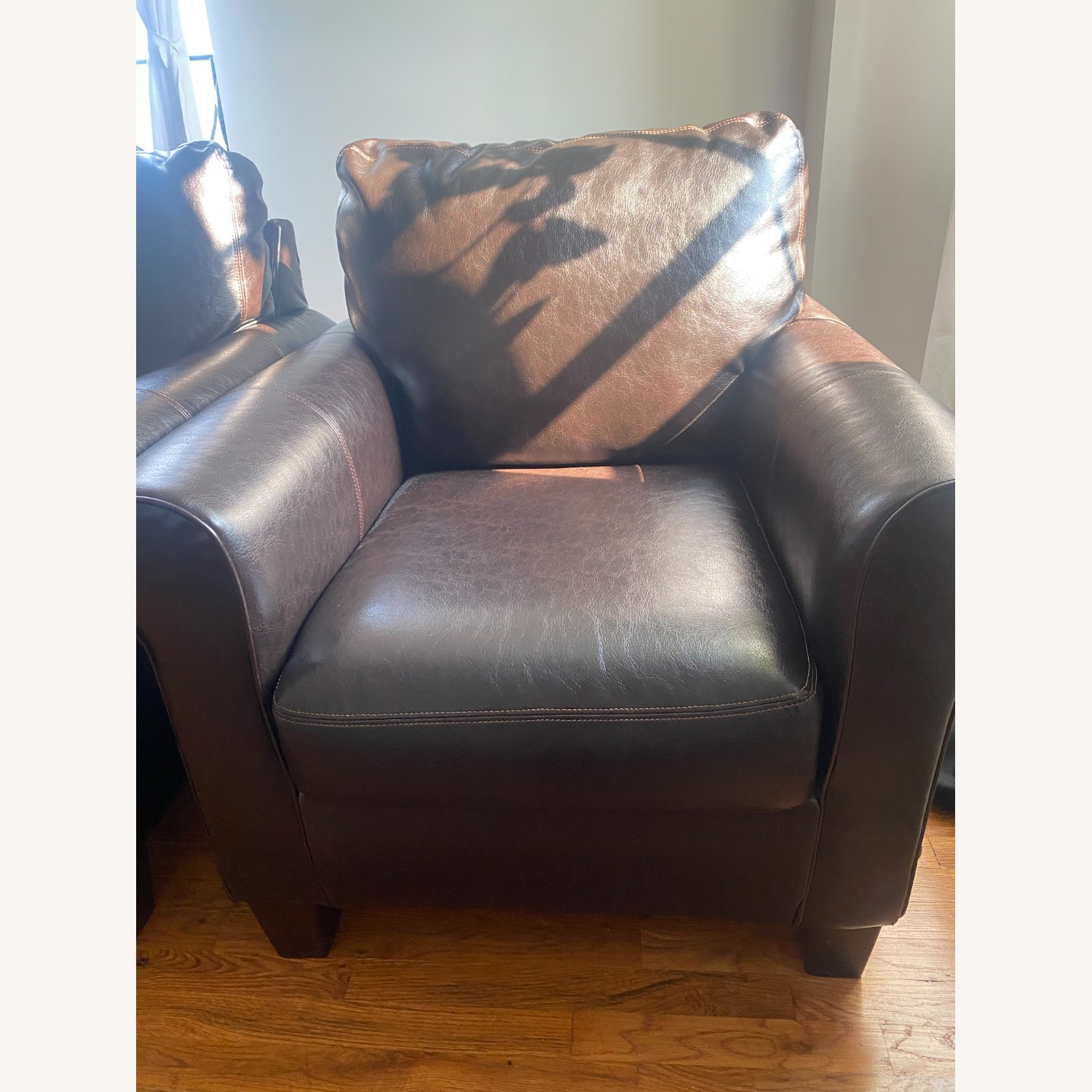 Ashley Furniture 2 Dark Brown Leather Arm Chairs - image-1