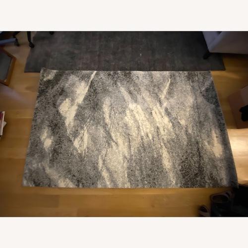 Used 5x8 Multi-Color Rug for sale on AptDeco