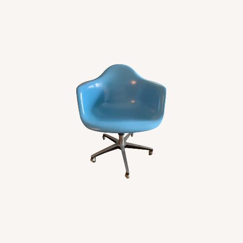 Used Modernica Blue Fiberglass Rolling Armchair for sale on AptDeco