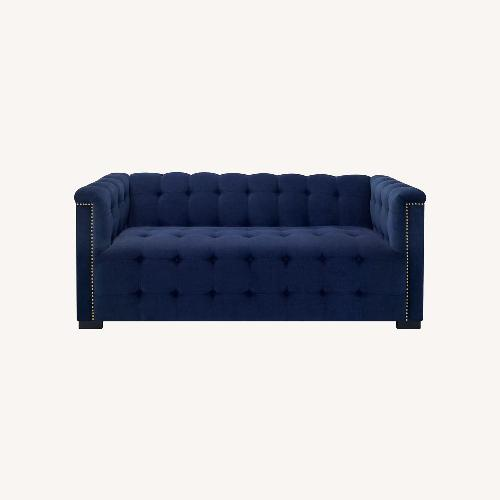 Used Raymour Flanigan Navy Tufted Loveseat for sale on AptDeco