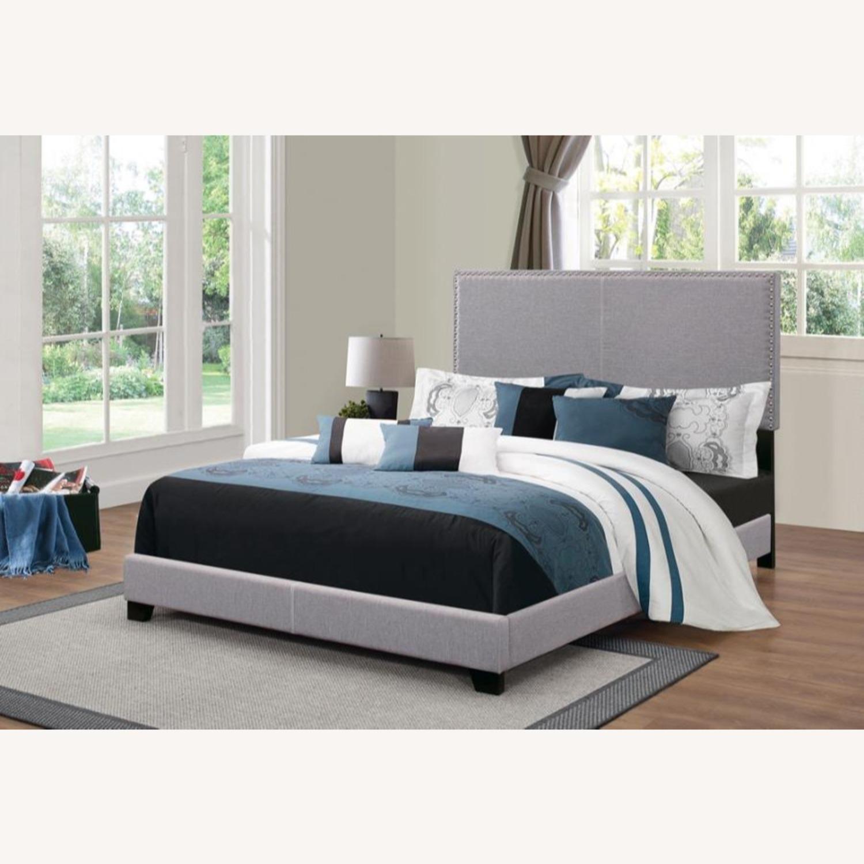 King Bed In Grey Fabric W/ Chrome Nailhead Trim - image-2