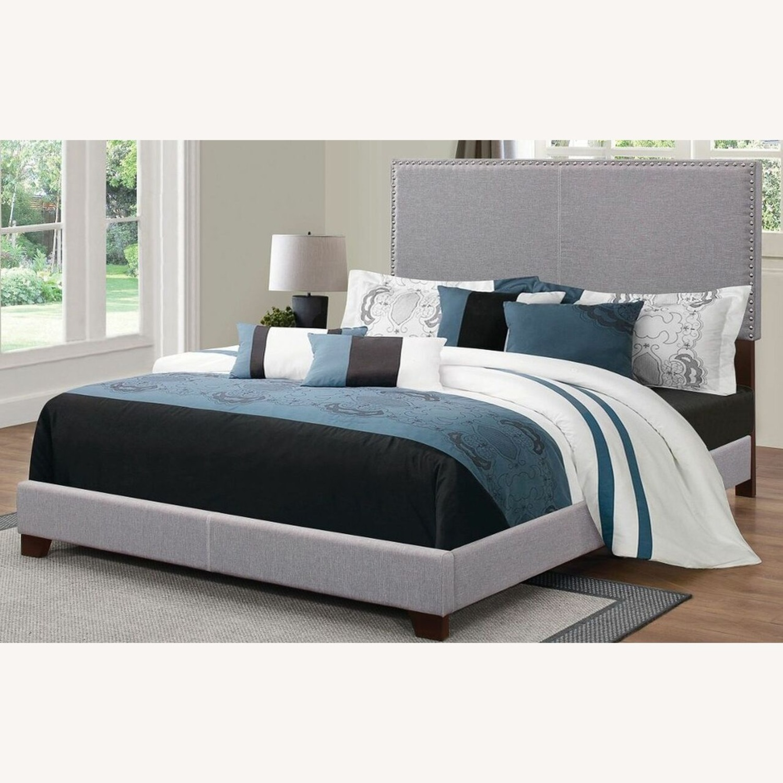 King Bed In Grey Fabric W/ Chrome Nailhead Trim - image-1