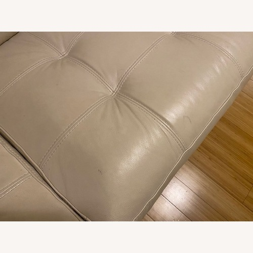 Used Macy's Leather Tufted Loveseat for sale on AptDeco
